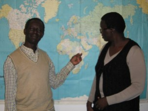Chaplain Kenyi Wani (left) and Victoria Matatio Elia show where South Sudan is on the map.