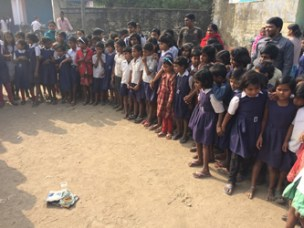 "School-led total sanitation ""triggering"" event: These school children in West Bengal, India are looking at a glass of water and fresh feces. Flies will pass from the water to the feces and back... This demonstrates how water can get polluted with pathogens."