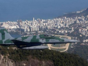A Brazilian Air Force plane flies during an exercise ahead the Rio 2016 Olympic Games in Rio de Janeiro, Brazil.