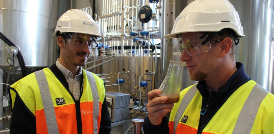 David Lapeña Gómez and Gergely Kòsa smelling the mix of cellulosic sugar from Borregaard and by-products from animals and fish that are added in the fermentation process.